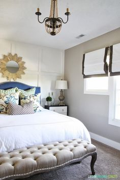 Gorgeous Guest Bedroom Makeover - tons of DIY projects in this little space. Love the accent wall and pillow fabrics!