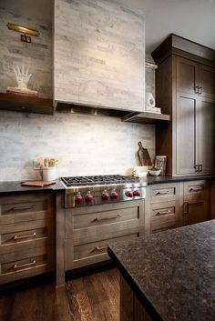 Perfection design here with black granite countertops, custom stain white oak cabinets and marble tile backsplash and hood vent. Brass fixtures, open shelving and wood flooring add the finishing touches to this stunning kitchen. Design by Veranda Estate Homes. #modernfarmhouse #farmhousekitchen #modernkitchen #whiteoak #oakcabinets #blackgranite #marbletile #marblehood #openshelving #brass Home Interior, Interior Design Kitchen, Modern Interior, Home Decor Kitchen, Home Kitchens, Kitchen Walls, Decorating Kitchen, Kitchen Backsplash, Stone Backsplash