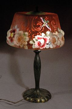 RED PUFFY PAIRPOINT LAMP FLOWERS AND HUMMINGBIRDS IT IS GORGEOUS WHEN LIT UP