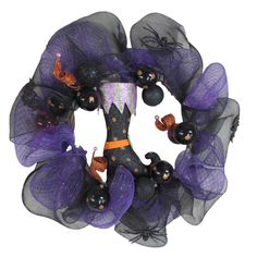 Add this black and purple witch inspired halloween wreath to your front door.