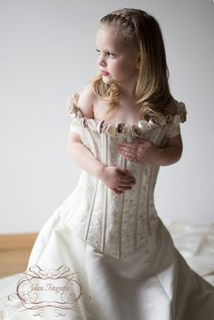 little girl in mommy's weddingdress, natural light, window, styled portret, fine art