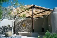 Custom steel framed residential shade structure with natural wood latillas.