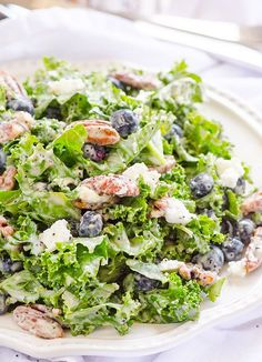 Kale, Blueberry, Goat Cheese and Candied Pecans Salad -- Clean Eating salad with homemade poppy seed dressing. (w/o pecans) Healthy Salad Recipes, Clean Eating Recipes, Real Food Recipes, Vegetarian Recipes, Cooking Recipes, Healthy Foods, Gf Recipes, Family Recipes, Lunch Recipes