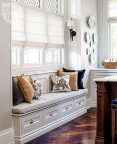Window seat with built-in drawers, piped cushion and lots of pillows!