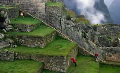 Tourists climb the stone stairs of Machu Picchu in 1995. This is always been a dream of mine to see!
