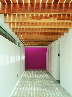 French By Design: Natural light, natural wood and very pink wall.