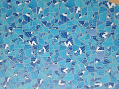 Detail view of Apple Store tile mosaic in Barcelona using colors from the Stocks iOS app icon