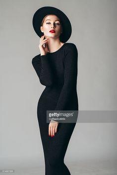 Stock Photo : Studio shot of young beautiful woman wearing retro hat