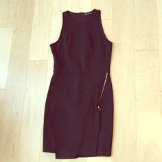 Black Zara Dress Hot black dress from Zara! This dress is form fitting and hits above the knee. Exposed zipper detail on the front. In excellent condition. Size Medium. Zara Dresses Mini