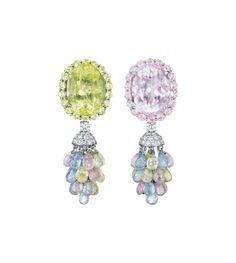 PHILLIPS : NY060213, , A Pair of Kunzite, Lemon Quartz, Multi-Color Sapphire and Diamond Ear Pendants Each suspending a briollete cluster drop, composed of kunzite, lemon quartz and multi-color sapphires, from a pavé-set diamond cap and circular-cut diamond spacer, to the oval-cut kunzite and lemon quartz surmount within a circular-cut kunzite and lemon quartz surround, mounted in 18K white gold, length 2 inches.