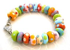 Sunspots bracelet by LushLampwork, via Flickr