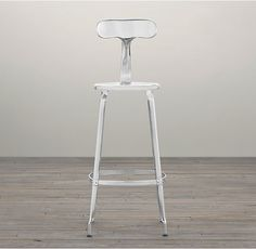 RH's French T-Back Stool:Popularized in 21st-century French factories, our industrial-inspired stool is built of metal from backrest to base. Its ergonomic T-shaped design makes it a functional and enduring addition to any cottage industry.