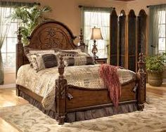 Rich wood tones with scrollwork on high, arched headboard, palms to reflect the Southern coastline, elegant bedding, neutral paint on walls Winter Bedroom, Home Bedroom, Bedroom Furniture, Bedroom Ideas, Always Kiss Me Goodnight, Tuscan Decorating, Decorating Ideas, Pretty Bedroom, Bed Styling