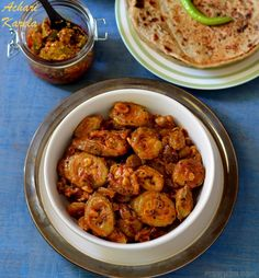 Achari Karela cooked in a tangy sweet and sour sauce with pickle spices
