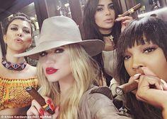 Tobacco fix: Khloe shared this selfie showing Kourtney, Kim and pal Malikka Haqq smoking h...