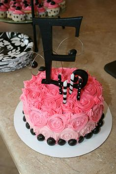 Pink and Black theme little girls birthday cake. Multi-colored pink flowers.