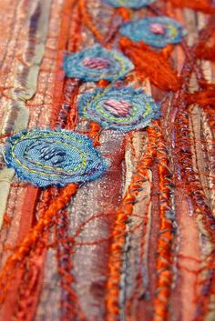 take photos in close detail as a hint of the art rather than a distant shot of the whole piece     textile panel - detail | Flickr - Photo Sharing!