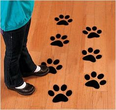 Paw Print Floor Decals (12) . Follow the paw prints all the way to fun! Have guests follow these animal tracks from activity to activity or use the pawprints to guide groups on a treasure hunt, or even to the party table! These vinyl paw print decals cling to any smooth surface, then come off easily after use. Price is for 12 decals; 16.5 cm x 17.8 cm