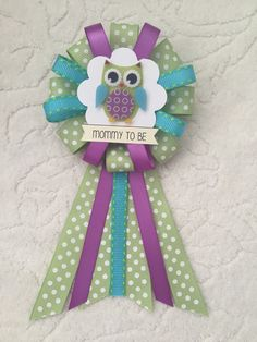 A personal favorite from my Etsy shop https://www.etsy.com/listing/249558852/mommy-to-be-ribbon-corsage-for-baby