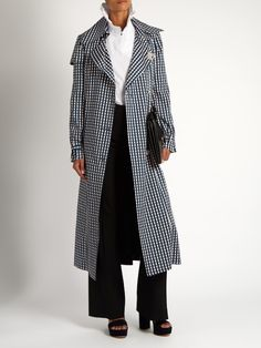 Jette gingham-print twill trench coat | PREEN BY THORNTON BREGAZZI Summer's essential gingham continues to rule into Pre-AW16, and Preen by Thornton Bregazzi's blue and pale-pink Jette trench coat is a slick way to wear it. It's cut from mid-weight twill to a calf-skimming length, and detailed with classic belted cuffs and a voluminous box-pleated back. Note the crystal-embellished buttons – a typically offbeat finisher.