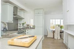 The beautiful, soft coloured kitchen at Lower Goosewell Cottage with it's massive oven!