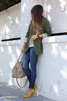 skinny jeans. statement yellow pump. oversized olive green jacket