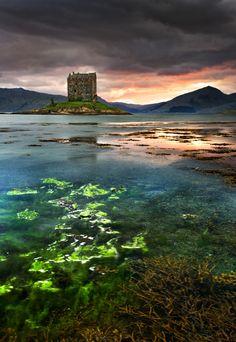 Castle Stalker in Scotland set on a tidal islet on Loch Laich.
