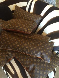 I never would have thought to repurpose old Louis Vuitton bags in this way; never know what you'll find at #hpmkt !