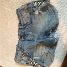 Billabong jean shorts Light wash. Lace up detail on sides. Size 26. Distressed. Billabong Shorts Jean Shorts