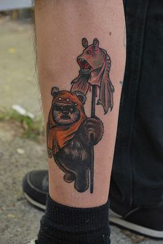 #JarJarBinks on a Stick #Tattoo: Sorry #GeorgeLucas, no one likes Jar Jar Binks. #StarWars fans have even re-edited movies to create a #deathscene for Jar Jar Binks. So this tattoo of an #Ewok with Jar Jar Binks' #decapitated head on a stick holds a special place in our hearts.