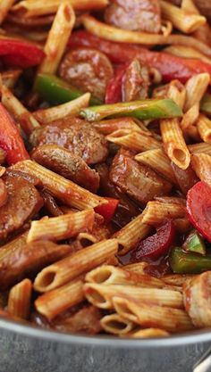 Skillet Italian Sausage & Peppers with Penne ~ DELICIOUS! comforting italian sausage and pepper penne pasta is cooked in one skillet and comes together in 30 minutes or less for a quick and easy weeknight meal. Pork Recipes, Cooking Recipes, Easy Cooking, Budget Cooking, Recipes With Sausage Brats, Oven Recipes, Penne And Sausage Recipe, Vegetarian Cooking, Penne Sausage Pasta