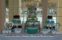 Baby Shower Centerpieces | ... baby shower table with 2 cupcake stands green punch heart decorations