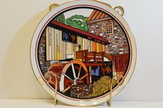 DECORATIVE PLATE MADE BY  FRIENDS OF WORLD WIDE ART STUDIOS .