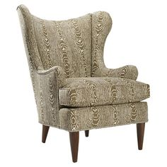 Beautifully blending modern and classic appeal, this wood-framed arm chair showcases a wingback silhouette and nailhead trim.         Pro...