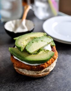 Smoky Sweet Potato Burgers with Roasted Garlic Cream and Avocado I http://howsweeteats.com