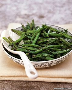 """It takes just a few minutes to transform steamed green beans from """"ho-hum"""" to """"hallelujah"""" with the help of store-bought tapenade and plenty of fresh parsley."""