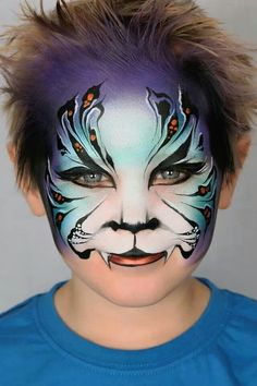 Jenny Saunders / Pixies face painting Tiger face paint. Really good blending of back ground colors.