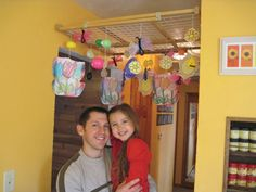 """From FamilyFun reader Nathan Bright:  """"We have a wooden baby gate that we no longer need, so I suspend it across our hallway ceiling to decorate for holidays and birthdays. The gate locks into place, and I tie my daughters' homemade decorations to it with string. Sometimes I place the gate at a lower level and cover it with blankets for Autumn, age 4, and Josie, 2, to use as a tent."""""""