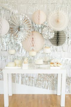 Metallic silver backdrop: http://www.stylemepretty.com/collection/2154/