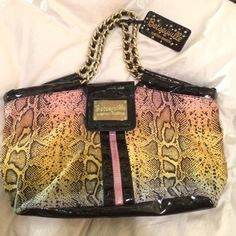 Betseyville by Betsey Johnson handbag Super fun and colorful handbag by Betsey Johnson. Features a multicolor snakeskin pattern with patent leather features. Includes gold chained straps and a snap-button close. Barley Used and in great condition! Betsey Johnson Bags