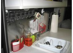 Stainless steel backsplash...use magnets to keep everything out on counter, even during travel.