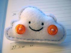 Cute felt cloud, wit rosie button cheeks!! Would make a darling hair accessory stuck on by girlie glue!  girlieglue.com.