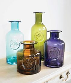 Coloured glass bottles look lovely with a single flower stem, or or just empty on a sunny windowsill