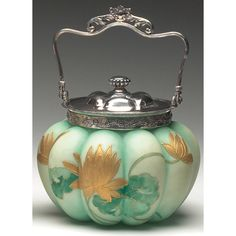 Mt. Washington biscuit jar, melon form in green satin glass with enameled gold water lilies, metal rim, lid and handle