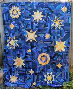 Okay I finally managed to wrangle the Starry Night quilt top enough to get some photos. I must admit there are a few strangling pieces of paper still attached to the back… but I promised a re… Star Quilt Blocks, Star Quilt Patterns, Star Quilts, Scrappy Quilts, Baby Quilts, Quilting Ideas, Man Quilt, Sampler Quilts, Patch Quilt