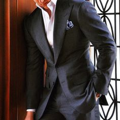 Charles Dean handcrafted 2-Piece suit with their Signature Peak Lapel and High Stand Two-Button Collar dress shirt.