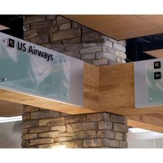 'Julie's Sign Shoppe' designed this airport wayfinding signage with StandOff Caps and Barrels.