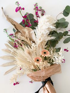 One of my favorite things to do is create floral arrangements. It is so fun to get creative and is therapeutic, too! I have a new found obsession with dried flowers. I purchased a few variations du… Dried Flower Bouquet, Dried Flowers, Engagement Party Themes, Dried Flower Arrangements, Local Florist, Ornamental Grasses, Real Flowers, Floral Bouquets, Bud Vases