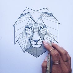 Finishing touches on this most enjoyable #geometric #lion #tattoo // but let's…