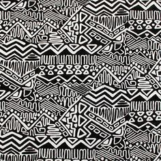"Black Aztec Glyphs on White Cotton Jersey Blend Knit Fabric - Black aztec glyph design on a natural white color jersey rayon blend knit.  Fabric is light to mid weight with a nice stretch and drape.  Design repeat measures 8"".  ::  $6.00"